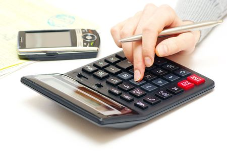 Business concept with pen and calculator Stock Photo - 6557816