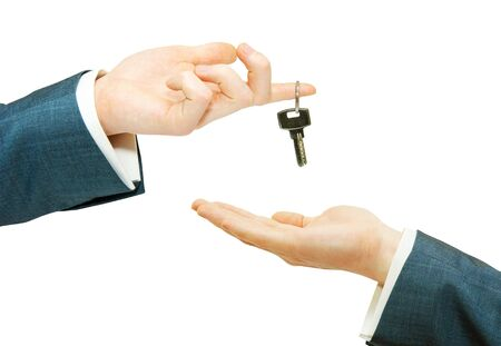 hand holds a key isolated on white Stock Photo - 6577046