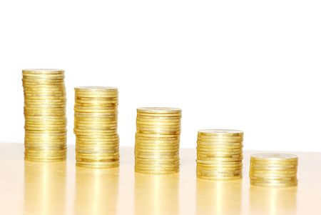 whiteness: towers of coins isolated on a whiteness Stock Photo