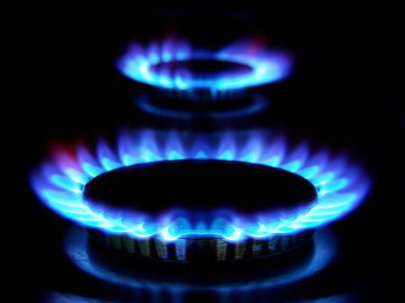 incandescence: flames of gas stove in the dark
