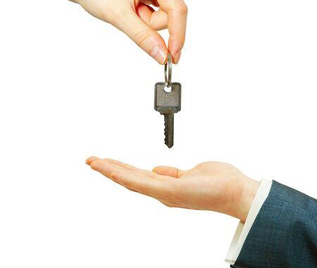 closing business: mano sostiene una clave aislada en blanco  Foto de archivo
