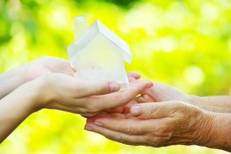 The house in human hand Stock Photo - 7558540