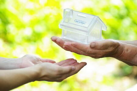 The house in human hand Stock Photo - 7558545
