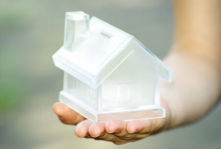 The house in human hands Stock Photo - 7558542