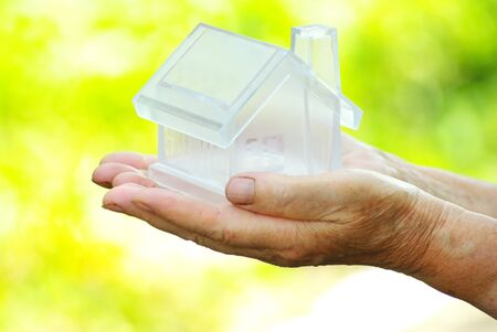 The house in human hand Stock Photo - 7615679