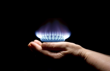 gas stove: Hands holding a flame gas