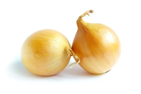 Ripe onion on a white background photo