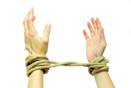 Tied hands isolated on a white background photo