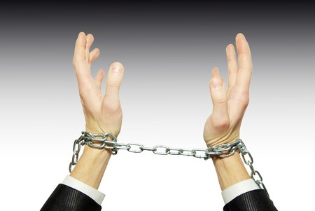 Hands in chains on a white background photo