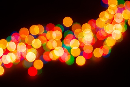 Abstract christmas lights as background on black photo