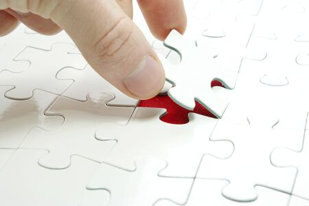 doing business: hands holding a puzzle piece . business concepts