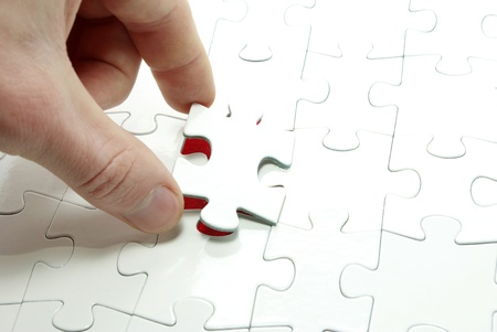 games hand: hands holding a puzzle piece . business concepts