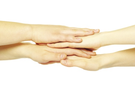 pile of hands isolated on a white photo