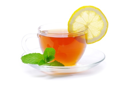 tea in cup with leaf mint and lemon isolated on white  photo