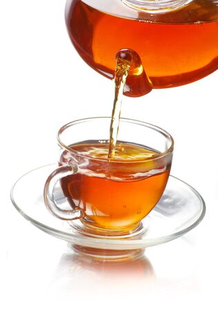 tea being poured into glass tea cup Stock Photo