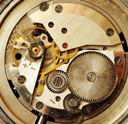 Closeup of old metal clock mechanism photo