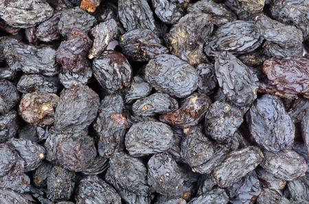 a closeup of dark brown raisins photo