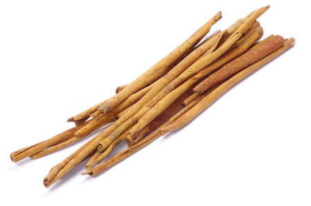 'cinnamon bark': cinnamon bark on a white background