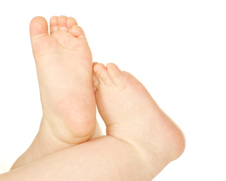 newborn baby feet and hands isolated on white photo