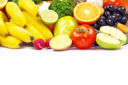 Fresh fruits and vegetables isolated on white photo