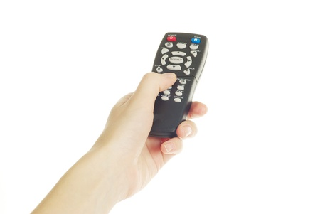 A hand holding a remote control isolated over a white background Stock Photo - 10519430