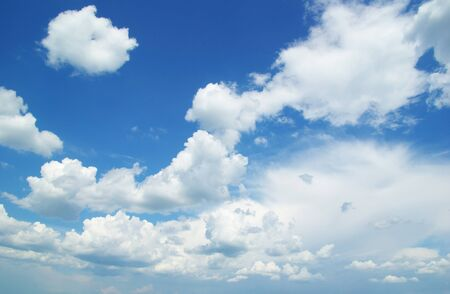 dispel: blue sky background with tiny clouds Stock Photo