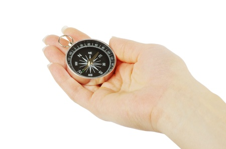 Compass in a hand isolated on the white Stock Photo - 11065379