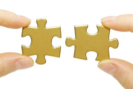 puzzle in hands isolated on white background photo