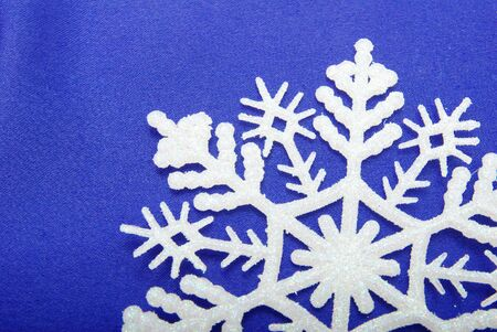 snowflakes isolated on blue background photo