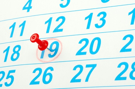 Red circle on a calendar concept for an important day photo