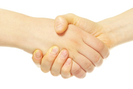 closeup of two men shaking hands isolated over white photo