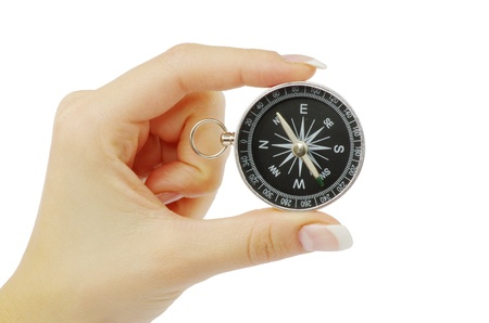 Compass in a hand isolated on the white Stock Photo - 11367674