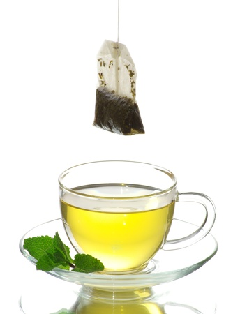 tea in cup with leaf mint  isolated on white  Stock Photo