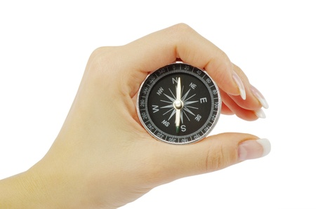 Compass in a hand isolated on the white Stock Photo - 12016721