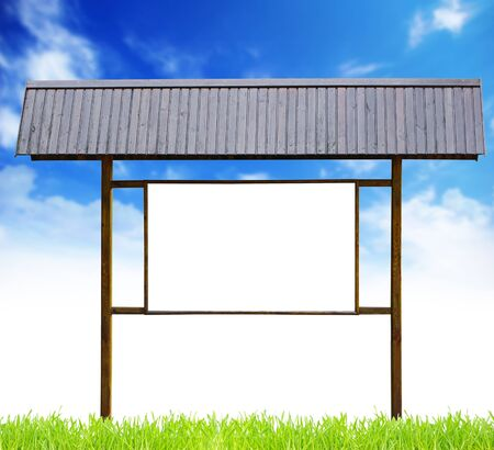 eminence: wooden signboard with meadow and blue sky