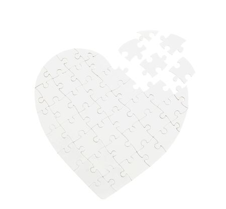 white jigsaw puzzle heart shape on white photo