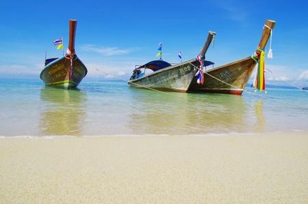 longtail: Tropical beach, longtail boats, Andaman Sea, Thailand Stock Photo