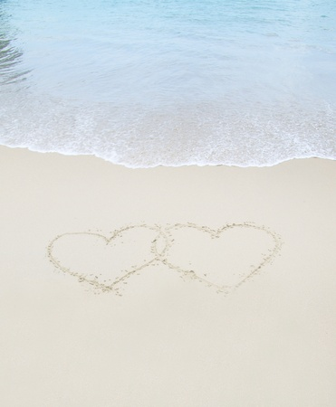 sand drawing: hearts drawn in the sand