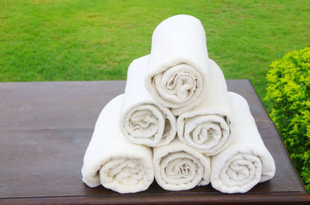 wrapped in a towel: white towel in basket for spa Stock Photo