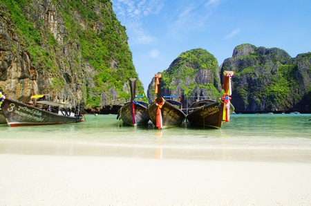 Tropical beach, longtail boats, Andaman Sea, Thailand photo