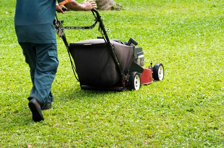A man mowing the lawn photo