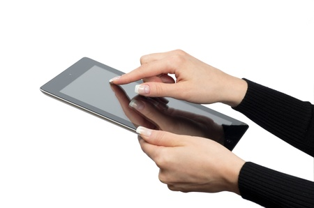 hands with tablet computer on white photo
