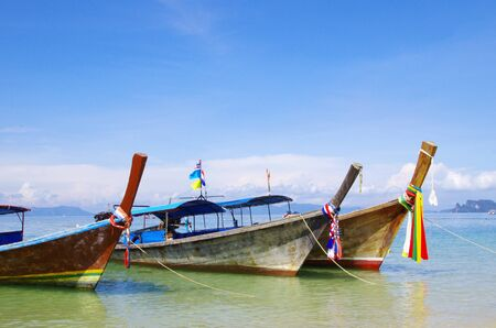 longtail: Tropical beach, longtail boats, Andaman Sea, Thailand Stock Photo