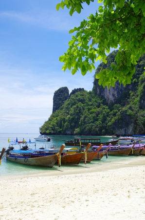 Tropical beach, longtail boats, Andaman Sea, Thailand Stock Photo