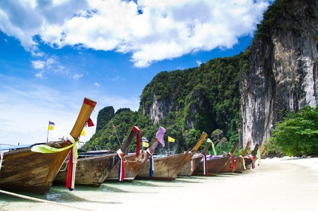 KRABI: Tropical beach, longtail boats, Andaman Sea, Thailand Stock Photo