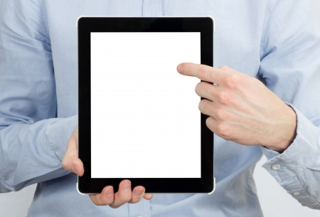 hands holding the tablet computer photo