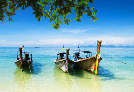 boats and islands in andaman sea Thailand photo