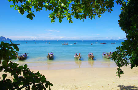 longtail boats on a tropical sea photo