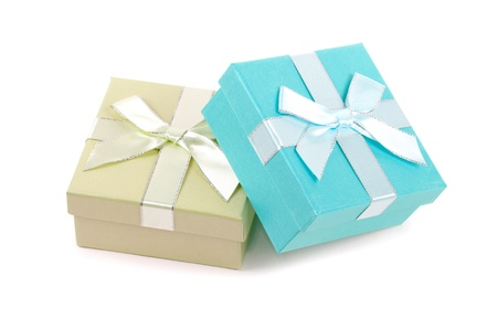 Christmas box gifts with satin bow isolated on white background Standard-Bild