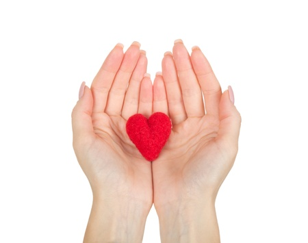 Hand holding the heart isolated on white background photo